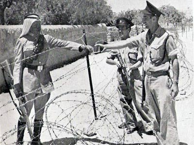 A Jordanian soldier and two Israeli policemen in Jerusalem, 1950.
