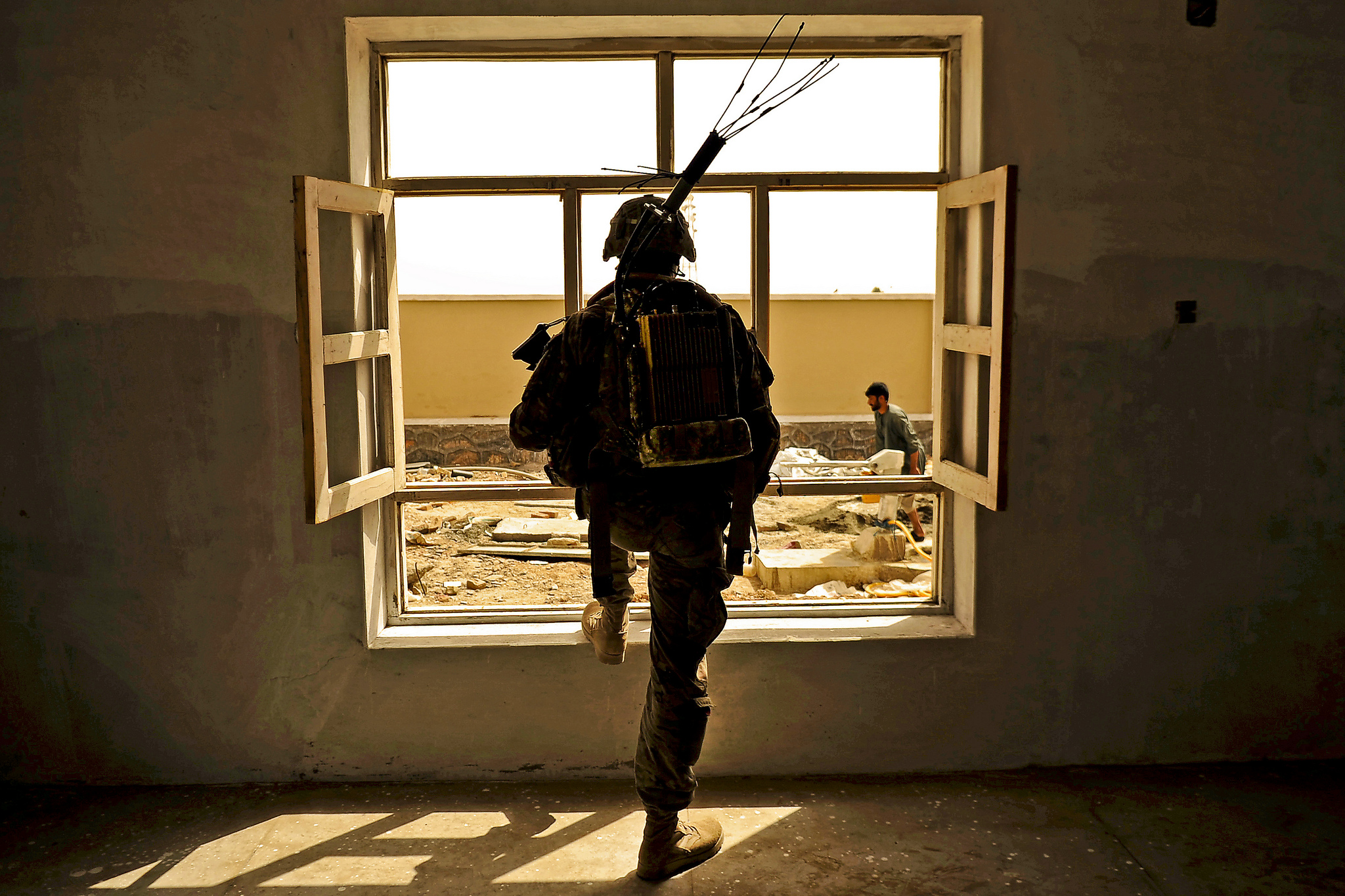 Alaskan National Guard Pvt. Lathaniel Ulofoshio provides security for fellow members of Kandahar Provincial Reconstruction Team while conducting a site survey of the Sanjaray health clinic May 24, 2012 in Kandahar, Afghanistan. Flickr / The U.S. Army