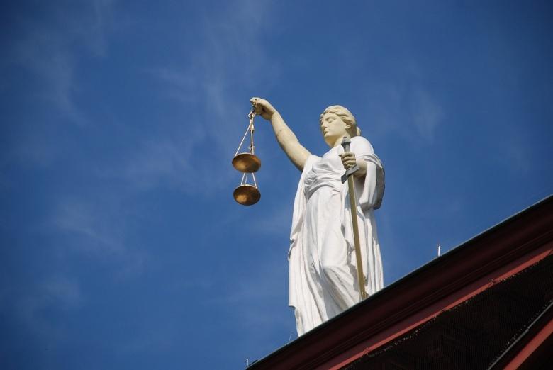 Image: Lady Justice. Photo via Pixabay/AJEL, public domain.