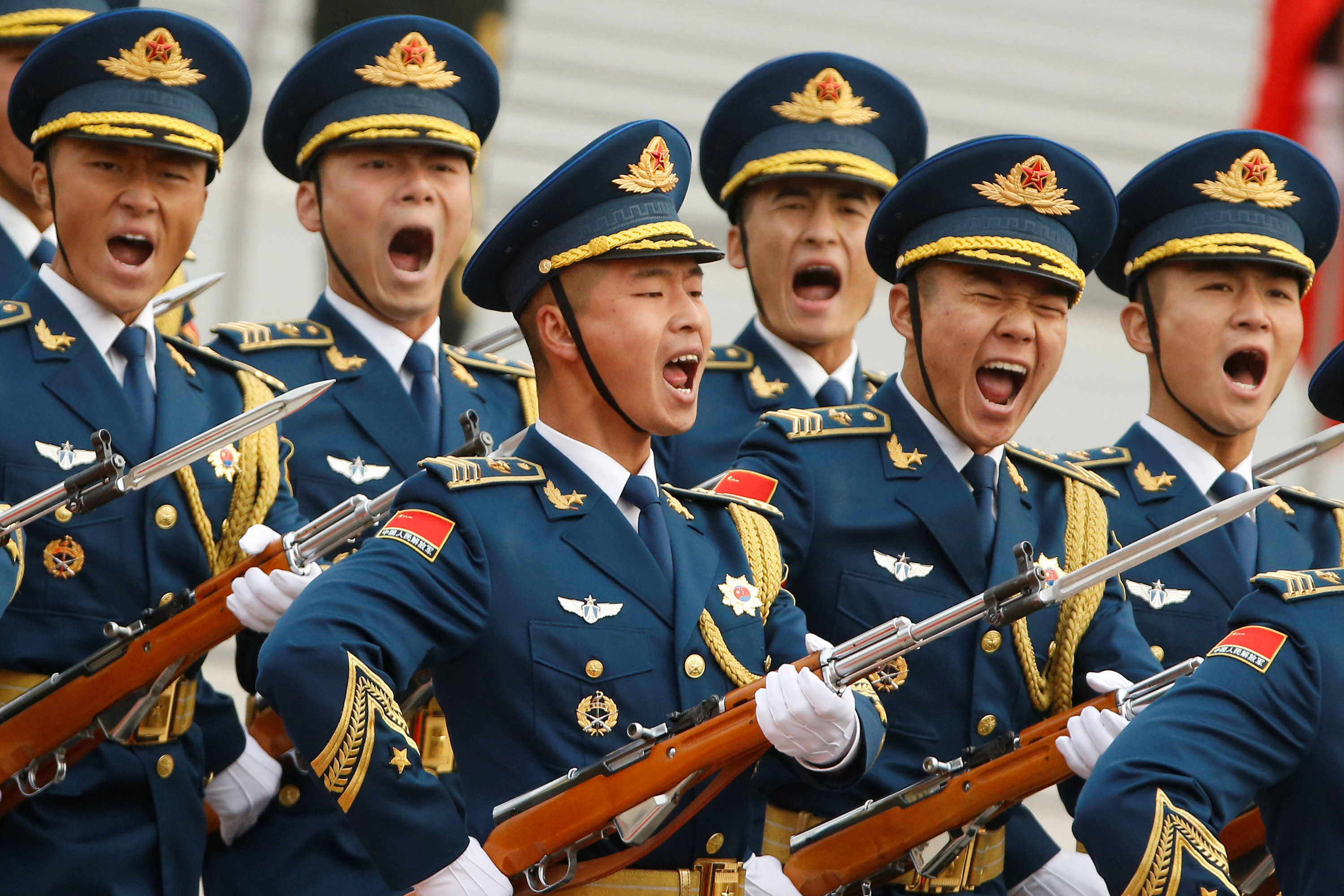 Military troops march during a welcoming ceremony for U.S. President Donald Trump in Beijing