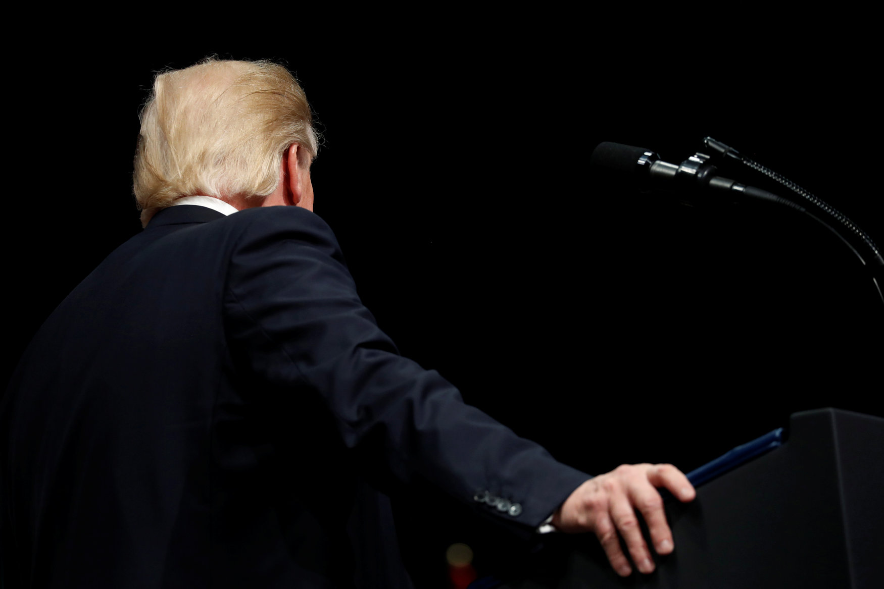 U.S. President Donald Trump turns to address others onstage during his remarks at a graduation ceremony at the FBI Academy on the grounds of Marine Corps Base Quantico in Quantico, Virginia, U.S. December 15, 2017. REUTERS/Jonathan Ernst