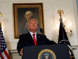 U.S. President Donald Trump pauses during a statement on the deadly protests in Charlottesville, at the White House