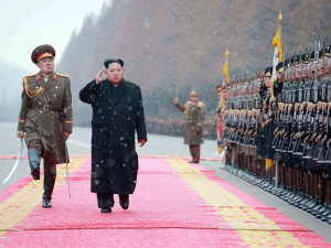 North Korean leader Kim Jong Un salutes during a visit to the Ministry of the People's Armed Forces on the occasion of the new year