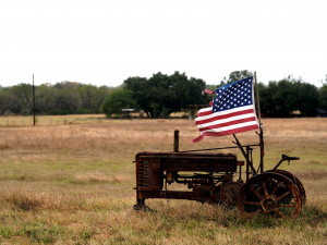 A tattered U.S. flag flies on an old tractor in a farm field outside Sutherland Springs, near the site of the shooting at the First Baptist Church of Sutherland Springs,Texas