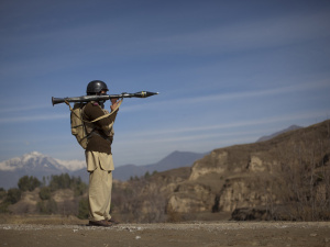 Pakistani soldier Hamed holds a rocket launcher while securing a road in Khar, the main town in Bajaur Agency, located in Pakistan's Federally Administered Tribal Areas (FATA) along the Afghanistan border, March 2, 2010. REUTERS/Adrees Latif