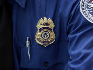 A Transportation Security Administration (TSA) official's wears a TSA badge at Terminal 4 of JFK airport in New York City