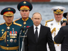 Russian Defence Minister Sergei Shoigu, Commander of Western military district Andrei Kartapolov, President Vladimir Putin and Commander-in-Chief of the Russian Navy Vladimir Korolev arrive to attend the the Navy Day parade in St. Petersburg