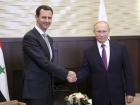 Vladimir Putin shakes hands with Bashar al-Assad during a meeting in the Black Sea resort of Sochi, November 20, 2017. Sputnik/Mikhail Klimentyev/Kremlin via Reuters