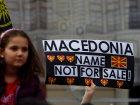 "A woman holds banner reading ""Macedonia name not for sale"" during a protest organized by the ""We are Macedonia"" movement as they rally against the name change demanded by Greece, in Skopje, Macedonia March 4,2018. REUTERS/Ognen Teofilovski"
