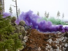 """Image: """"As green and purple smoke conceals them, U.S. Army Soldiers, the Iron Troop, with 3rd Squadron, 2nd Cavalry Regiment, stationed out of Vilseck, Germany, set up their positions behind a berm to fire at enemy targets during a live fire exercise at Tapa Training Area, Estonia, Mar. 8-11, 2016. (U.S. Army photo by Staff Sgt. Steven M. Colvin)"""""""