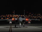 A U.S. Air Force F-15 Eagle, assigned to the 142nd Fighter Wing, Oregon Air National Guard, returns to Nellis Air Force, Nevada, after a night sortie in support of the Weapons Instructor Course, June 8, 2017.