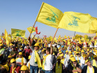 Supporters of Lebanon's Hezbollah leader Sayyed Hassan Nasrallah display Hezbollah and Lebanese flags in Baalbek, Bekaa valley, in eastern Lebanon