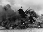 USS Arizona burning after the Japanese attack on Pearl Harbor. Wikimedia Commons/Public domain