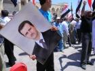 March in support of Bashar al-Assad in prewar Raqqa, Syria. Flickr/Beshr Abdulhadi