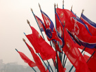 North Korean flags. Flickr/Creative Commons/@fljckr