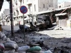 Image: Bombed-out vehicles in Aleppo, Syria, 2012. Photo via VOA/Scott Bobb.