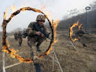 Soldiers of People's Liberation Army (PLA) Lanzhou Military Region jump through a burning obstacle during a training session at a military base in Tianshui, Gansu province, China