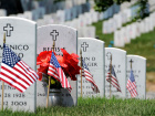 Flags and wreaths rest at tombstones in Arlington National Cemetery. Wikimedia Commons/Department of Defense