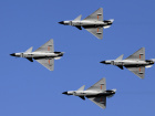 J-10 fighter jet aerobatic team of China Air Force fly in formation during a rehearsal on the outskirts of Beijing