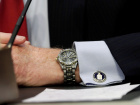 "An cufflink with CIA logo is seen on CIA Director John Brennan's shirt as he testifies before the Senate Intelligence Committee hearing on ""diverse mission requirements in support of our National Security"", in Washington"