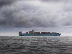 A cargo ship sails across the ocean.