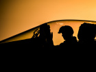 A pilot performs pre-flight checks on an F/A-18C Hornet on the flight deck of USS Dwight D. Eisenhower. Flickr/U.S. Navy