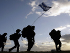 Israeli soldiers cross the Gaza border back to Israel early morning