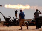 Anti-Gaddafi fighters fire a multiple rocket launcher near Sirte, one of Muammar Gaddafi's last remaining strongholds, September 24, 2011. Libyan provisional government forces backed by NATO warplanes swarmed into the city of Sirte on Saturday but weathered heavy sniper fire as they tried to win control of one of deposed leader Muammar Gaddafi's last bastions of support. REUTERS/Goran Tomasevic