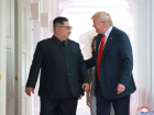 U.S. President Donald Trump walks with North Korean leader Kim Jong Un at the Capella Hotel on Sentosa island in Singapore in this picture released on June 12, 2018 by North Korea's Korean Central News Agency. KCNA via REUTERS