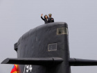 Taiwan President Tsai Ing-wen waves as she boards Hai Lung-class submarine (SS-794) during her visit to a navy base in Kaohsiung, Taiwan March 21, 2017. REUTERS/Tyrone Siu