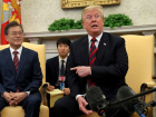 U.S. President Donald Trump gestures as he welcomes South Korea's President Moon Jae-In in the Oval Office of the White House in Washington, U.S., May 22, 2018. REUTERS/Kevin Lamarque
