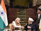 Narendra Modi with Hassan Rouhani. Wikimedia Commons/Narendra Modi