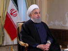 Iranian President Hassan Rouhani looks on during an interview on the state television in Tehran