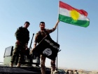 Peshmerga take down the ISIS flag. Flickr/Creative Commons/@Kurdishstruggle