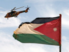 A helicopter is seen next to the Jordanian flag during the Eager Lion military exercise at the Jordan-Saudi Arabia border, south of Amman