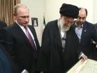 Image: Khamenei inspects the Quran Putin gave him. Khamenei.ir.