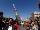 Supporters of the Houthi movement shout slogans as they demonstrate against the closure of Yemen's ports by the Saudi-led coalition in Sanaa, Yemen