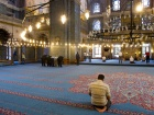 Praying in the New Mosque, Istanbul. Flickr/Brian Jeffery Beggerly