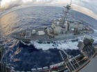 USS Chafee pulls alongside the Nimitz-class aircraft carrier USS George Washington. U.S. Navy photo by Mass Communication Specialist 3rd Class Jessica Gomez