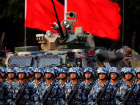 Troops prepare for the arrival of Chinese President Xi Jinping (unseen) at the People's Liberation Army (PLA) Hong Kong Garrison in one of events marking the 20th anniversary of the city's handover from British to Chinese rule, in Hong Kong