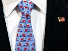A Republican National Convention staff member wears a tie with the convention logo of an elephant and an electric guitar, as final preparations continue before the start of the first day of the convention in Cleveland, Ohio