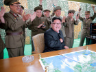Kim Jong Un reacts with Ri Pyong Chol and Jang Chang Ha during a test launch of ground-to-ground medium long-range ballistic rocket Hwasong-10 in this photo released June 23, 2016.