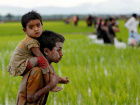 A Rohingya boy carries a child after after crossing the Bangladesh-Myanmar border in Teknaf, Bangladesh, September 1, 2017. REUTERS/Mohammad Ponir Hossain