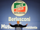 Forza Italia party leader Silvio Berlusconi waves during a rally for the regional elections in Palermo, Italy November 1, 2017. REUTERS/Guglielmo Mangiapane/File Photo