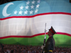 A soldier stands in front of the national flag during an Independence Day celebration in Tashkent August 31, 2012. Uzbekistan is marking the 21st anniversary of independence. REUTERS/Shamil Zhumatov