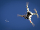 An airplane flies over a drone during the Polar Bear Plunge on Coney Island in the Brooklyn borough of New York January 1, 2015. The Coney Island Polar Bear Club is one of the oldest winter bathing organizations in the United States and holds a New Year's Day plunge every year. REUTERS/Carlo Allegri