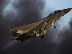 An Israeli air force F-15 fighter jet flies during an exhibition as part of the graduation ceremony of air force pilots at Hatzerim air base in southern Israel June 25, 2015. REUTERS/Amir Cohen