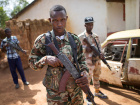 Armed fighters belonging to the 3R armed militia stands guard while their leader General Sadiki is talking to the media in the town of Koui, Central African Republic, April 27, 2017. Picture taken April 27, 2017 REUTERS/Baz Ratner