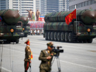 Intercontinental ballistic missiles (ICBM) are driven past the stand with North Korean leader Kim Jong Un and other high ranking officials during a military parade marking the 105th birth anniversary of country's founding father Kim Il Sung, in Pyongyang April 15, 2017. The missiles themselves were shown for the first time inside a new kind of canister-based launcher on Saturday. The trucks upon which they are mounted are originally designed to move lumber. REUTERS/Damir Sagolj/File Photo​