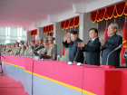 North Korean leader Kim Jong Un (3rd R) waves during the celebration of the 70th anniversary of the founding of the ruling Workers' Party of Korea, in this undated photo released by North Korea's Korean Central News Agency (KCNA) in Pyongyang on October 12, 2015. Isolated North Korea marked the 70th anniversary of its ruling Workers' Party on Saturday with a massive military parade overseen by leader Kim Jong Un, who said his country was ready to fight any war waged by the United States. Also pictured is se